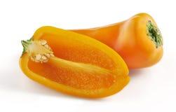 Två orange mini- spanska peppar på en vit bakgrund Royaltyfri Fotografi