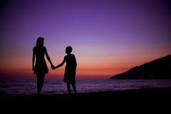 Två på en strand Fotografering för Bildbyråer