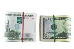 Två packar av 1000 - rublet och 50 - dollar Fotografering för Bildbyråer