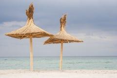 Två paraplyer på stranden royaltyfria foton