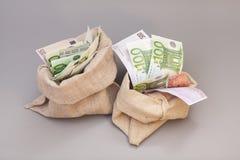 Två pengarpåsar med euro royaltyfria bilder