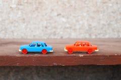 Två plast- bilar Fotografering för Bildbyråer