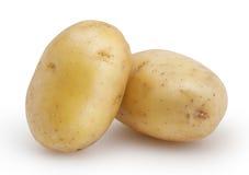 Två potatisar som isoleras på vit royaltyfri fotografi