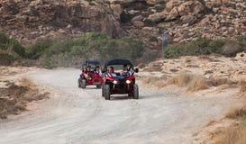 Två röda ATV-kvadratcyklar arkivfoto