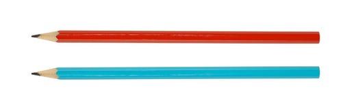Två röda blyertspennor och blått som isoleras på vit arkivbilder