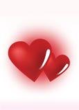 Två röda förälskelsehjärtor Arkivbild