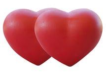 Två röda hjärtor föreställer förälskelse arkivfoto