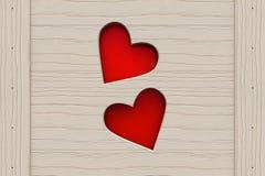Två röda hjärtor i ett trä stiger ombord Royaltyfri Bild