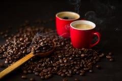Två röda koppar av espresso Royaltyfria Bilder