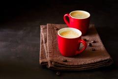 Två röda koppar av espresso Royaltyfri Fotografi