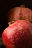 Två röda pomegranates Arkivfoton