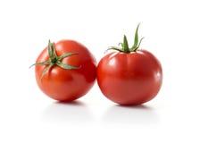 Två röda tomatfrukter arkivfoto