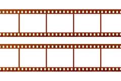 Två remsor av 35mm film som isoleras på vit bakgrund, slut upp Arkivbild