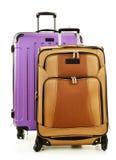 Två resväskor på vit bakgrund Fotografering för Bildbyråer