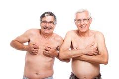 Två roliga nakna pensionärer Royaltyfria Bilder