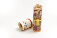 Två rullar av 50 euroräkningar Arkivfoton
