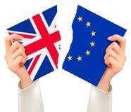 Två sönderrivna flaggor - EU och UK i händer Brexit begrepp Royaltyfria Foton