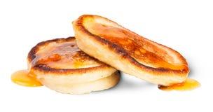 Två söta pannkakor med lönnsirap Arkivfoto