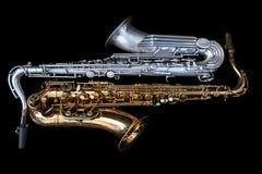 Två saxofoner som ner ligger royaltyfri bild