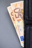 Två sedlar vid en nominellt värde 50 euros Fotografering för Bildbyråer