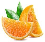 Två segment av orange frukt med sidor Royaltyfria Foton