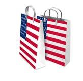 Två shoppingpåsar som öppnas och stängs med USA flaggan Arkivbilder