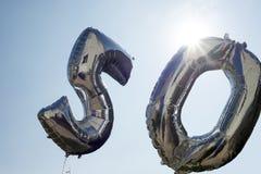 Två silverballonger för 50th Fotografering för Bildbyråer