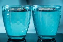Två slösar mång--fasetterade exponeringsglas på en olik bakgrund Royaltyfri Bild