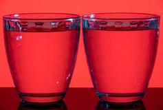 Två slösar mång--fasetterade exponeringsglas på en olik bakgrund Royaltyfri Foto