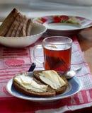 Två smörgåsar med smör på en platta Royaltyfri Fotografi