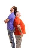 Två stående män tillbaka att dra tillbaka Fotografering för Bildbyråer