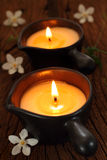Två stearinljus ljus för massage Arkivfoto