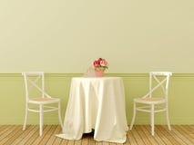 Två stolar med en kaffetabell Arkivfoto