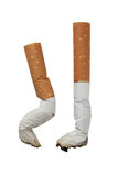 Två stumpar av cigaretter Arkivfoto