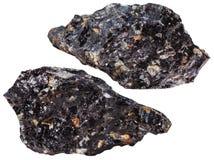 Två stycken av den isolerade mineraliska stenen för Obsidian Fotografering för Bildbyråer