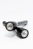 Två svarta ficklampor på vit bakgrund Arkivfoton