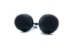 Två svarta mikrofoner på en vit bakgrund Royaltyfri Bild