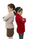 Två systrar grälar in Royaltyfri Bild