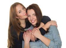 Två systrar, kopplar samman Royaltyfria Foton