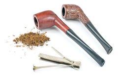 Två tobakrör och lokalvårdhjälpmedel Arkivbilder