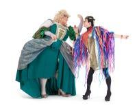 Två transvestit som har gyckel som tillsammans utför Royaltyfri Bild