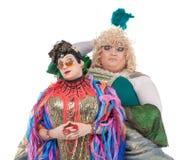 Två transvestit som har gyckel som tillsammans utför Arkivfoton