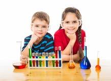 Två ungar med kemisk utrustning royaltyfria foton