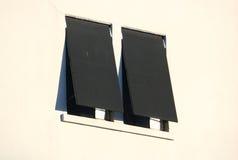 Två utomhus- industriella Windows och markiser Royaltyfria Foton