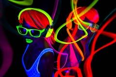 Två uv glöddansare för sexigt neon Fotografering för Bildbyråer