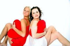 Två vänner i pajamas Fotografering för Bildbyråer