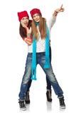 Två vinter kvinna som pekar på kopieringsutrymme Royaltyfria Foton