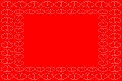 Två vita hjärtor som är röda och Arkivfoto