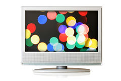TV. Flat LCD TV isolated with colorful lights on screen over white background Stock Photos
