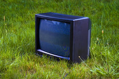 Tv. Photo of tv on the grass stock photos